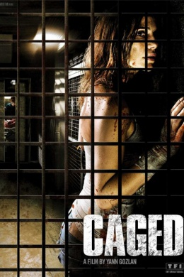 В клетке